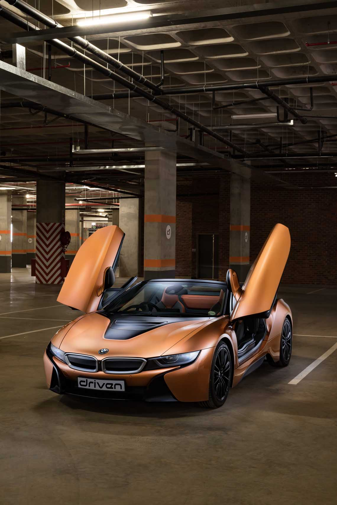 2018 Bmw I8 Roadster Hero Shot Showing The Doors Wheels And Side